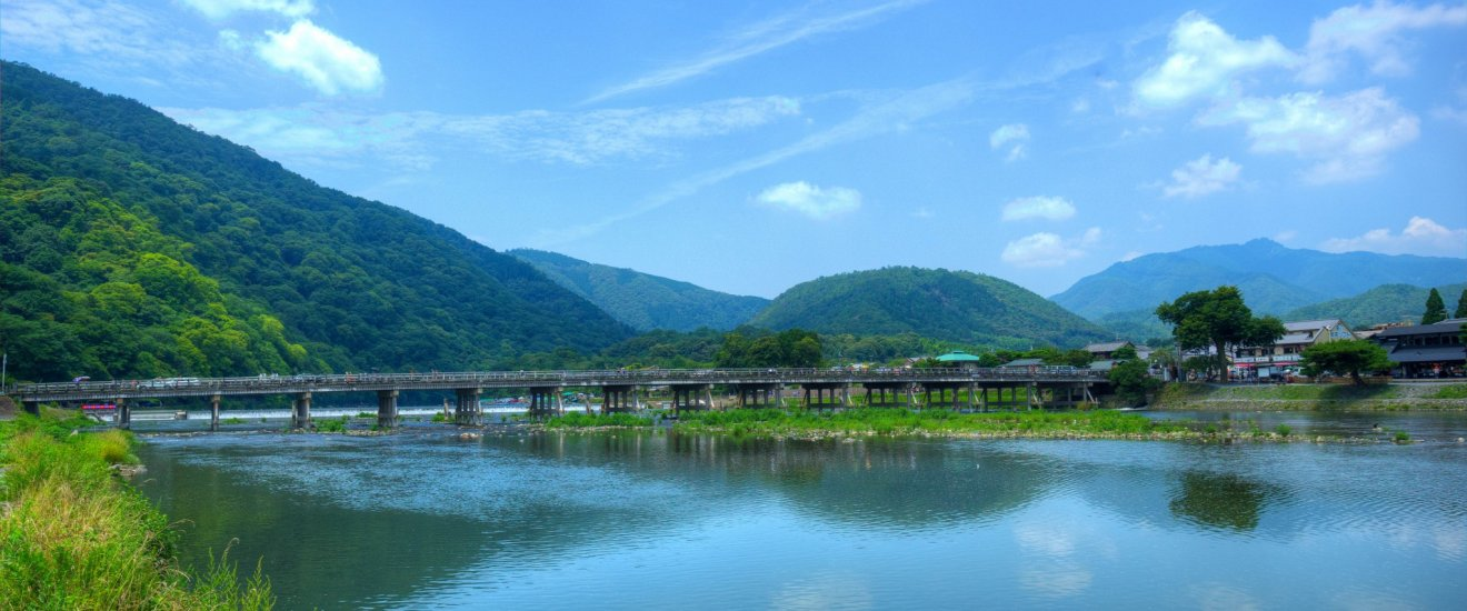 Togetsukyo Bridge framed by dramatic mountains.