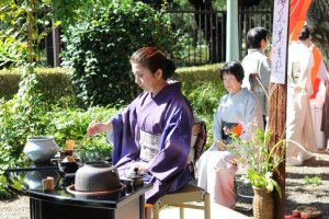 A woman performing outdoor tea ceremony