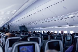 The 787 Dreamliner aircraft cabin has higher ceilings and LED lighting