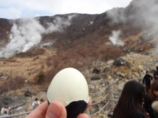 The eggs are not black--only the shells are, from the sulphur and iron in the onsen water.