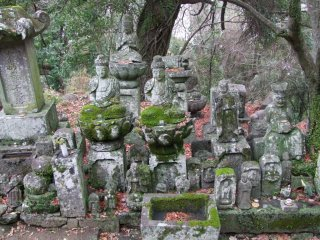 Many statues sit alone, but others are gathered in groups.
