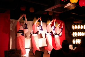 Members of one of Koenji's famous Awaodori dance troupes performs on stage.