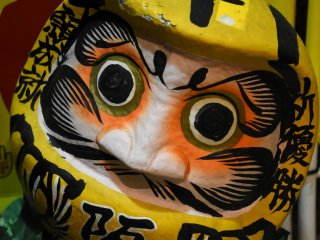 Yellow Daruma Doll displayed at the entrance of Izakaya Aji-Tora. The yellow color of course represents Hanshin Tigers!