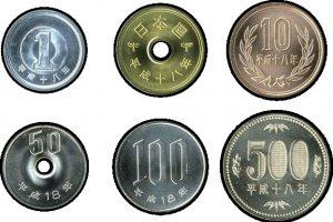 Japanese yen coins (clockwise from top left): 1 yen, 5 yen, 10 yen, 500 yen, 100 yen, 50 yen