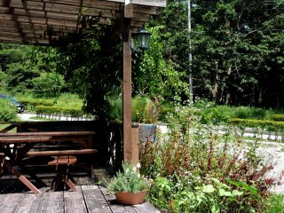 There were rustic tables and seats on the wooden deck in front of the bakery