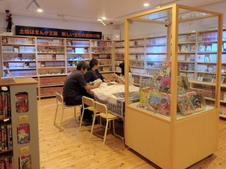 There is a small library in the back of the museum where visitors can sit and read from a collection of Japanese manga.