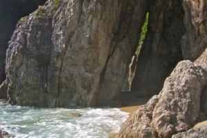 The cave on the sandy beach