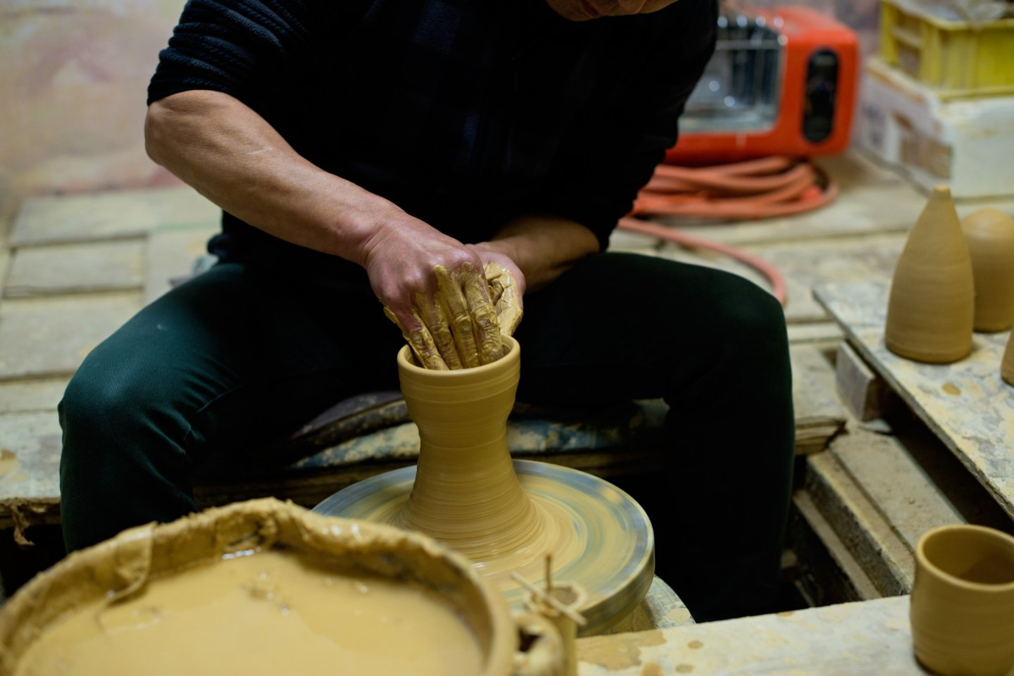 Mr. Kaneko working on a piece of pottery