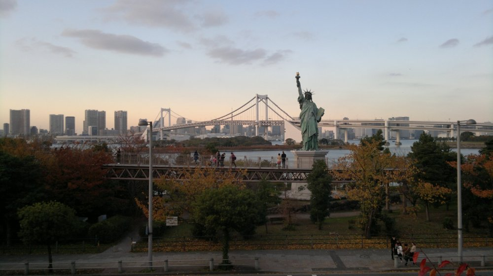The iconic Liberty Statue and Tokyo waterfront