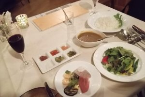 My dinner: salad, curry, pickles, jam, juice