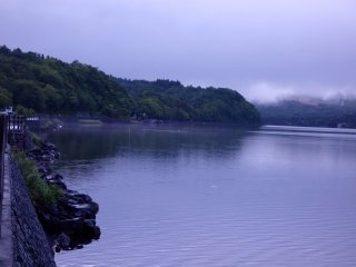 In addition to low-hanging clouds, mist and morning fog cling to the banks of the lake