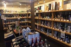 Shelves filled with a lot of sake bottles