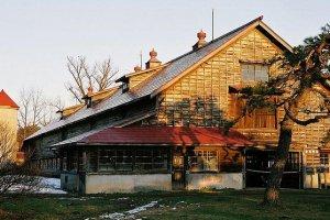 Rustic farm houses litter the landscape.