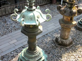 Colors of old metal and stone lanterns