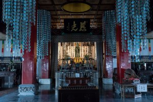 Inside the temple. Notice the pendulum string hanging from the hole in the roof.