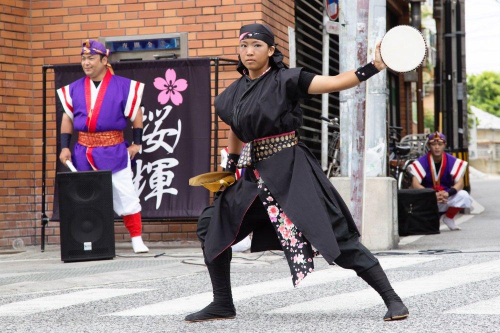 Eisa youth member performing in Kokusai Dori during summer