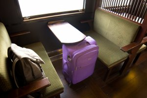 Comfortable seats and a table in the passenger carriage of Isaburo Shine