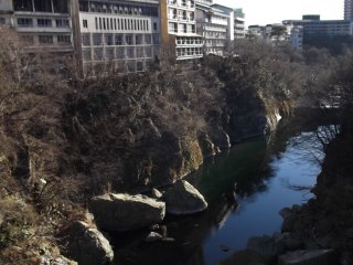 The riverside is lined with onsen hotels