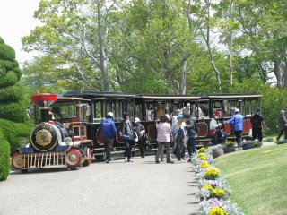 """""""Flower Train"""" makes a loop through the park with the guide explnations."""