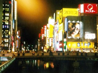 The neon lights are reflected on the river at Osaka's heartbeat Dotonbori. During the World Cup, fans would jump into the river to celebrate when their team won. See Japan at play in this unihibited place of fun.