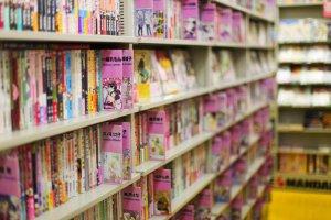 Shelves lined with pink manga and dōjinshi