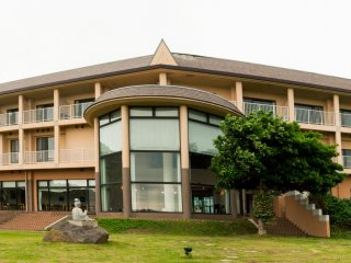 The building sits prominently on the coast line in a secluded stretch of Nishinoshima's coastline.
