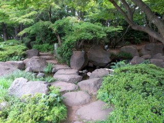 Stone pathway around the pond in Heisei Garden