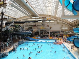 The indoor water park's wave pool and slides