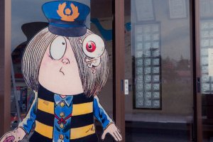 The anime's main character (Kitaro) dressed up as a station attendant.
