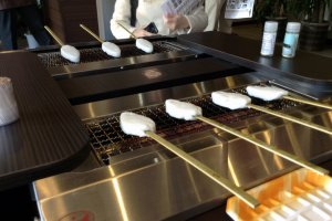 Grilling our own kamaboko at the factory store.