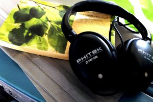Noise Cancelling headphones are effective and are complementary for Business Class passengers