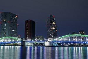 Night-time green lights illuminate the water front andKachidoki Bridge