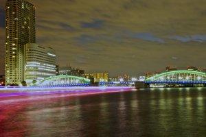 Ships pass by and belowKachidoki Bridge at night-time