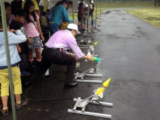 Children had lots of fun building their own water-powered rockets and then shooting them into the heavens...until half of them returned to earth and smashed into pieces.