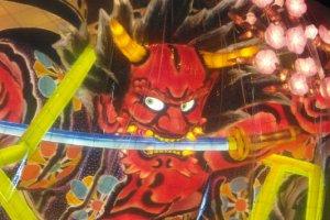 A fierce-looking devil trapped in plastic.