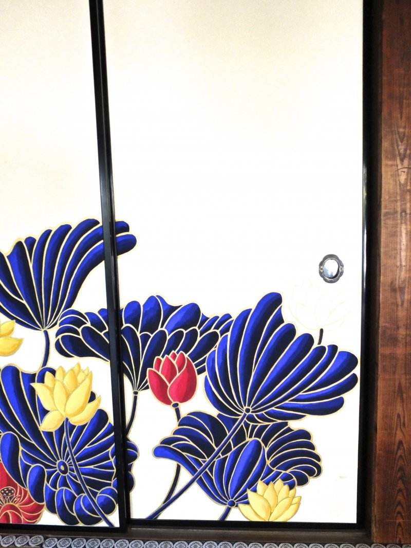 <p>Many of the lotus are painted right onto sliding doors</p>