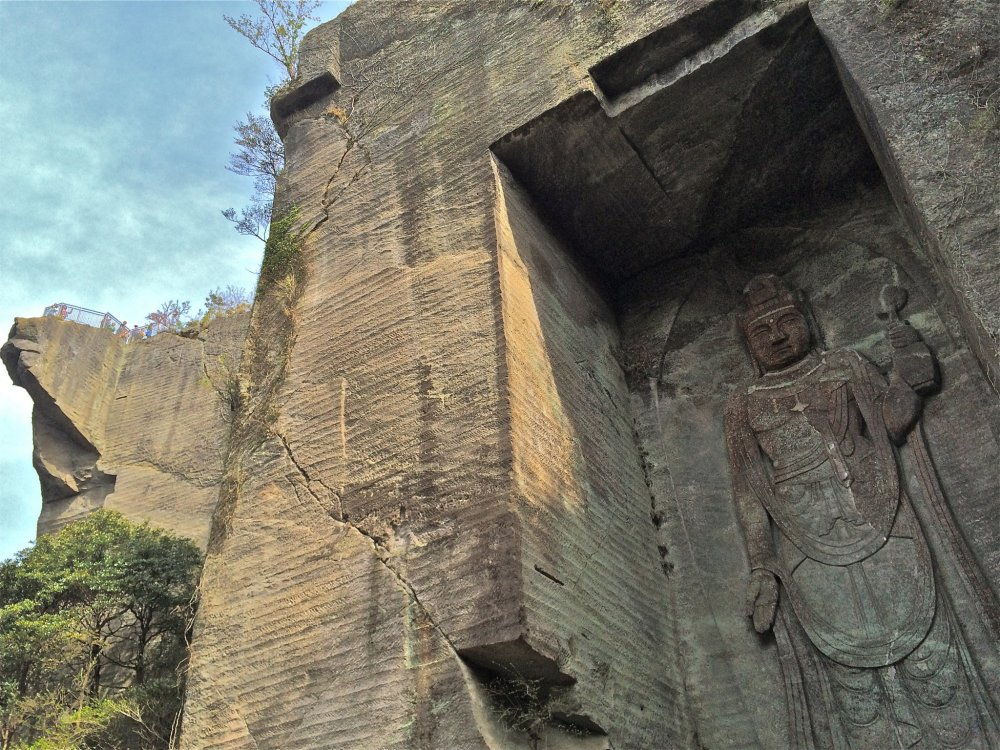 "Mt Nokogiriyama or ""Sawtooth Mountain"" acquired its distinctive profile from its history as a stone quarry during the Edo Period. Pictured here is Hyakusyaku Kannon and famous cliff, Jigokunozoki(地獄覗き), which literary means ""hell watch stand."""