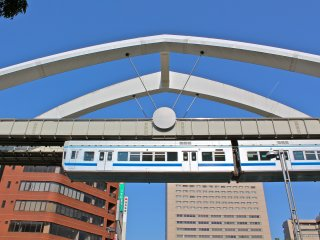"""The Chiba Urban Monorail earned the Guinness World Record title, """"World's Longest Suspended Monorail"""" in 2001. Here it is suspended above Chuo Park in Chiba City, Japan."""