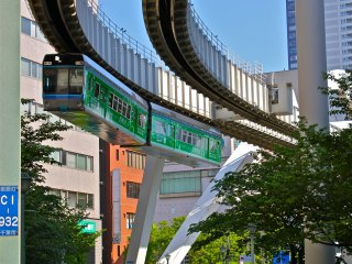 The suspended monorail cruising around the bend. Looks so awesome!