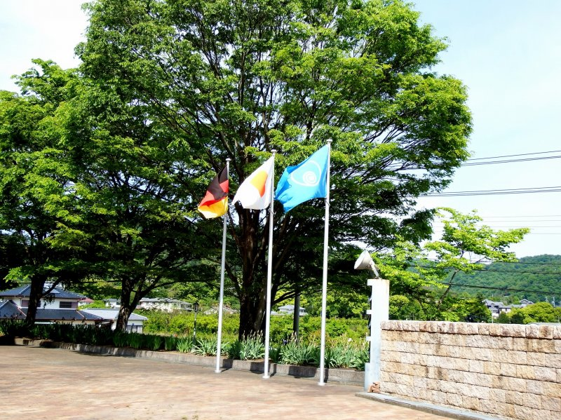 <p>Billowing flags of Germany, Japan and Naruto city</p>