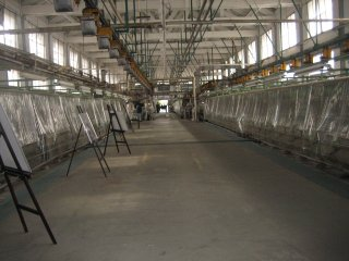 Inside the silk reeling factory. Export of the Japanese silk began as soon as the Yokohama port opened for trading in 1859. Seeing the high demand, the Meiji government understood the importance for the country's development and set up Tomioka Silk Mill in Gunma in 1872.