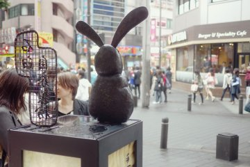 <p>The rabbit statue watching the street</p>