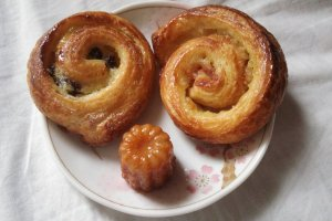 Delicious raisin pastry with patisserie custard, cinnamon roll and a canele