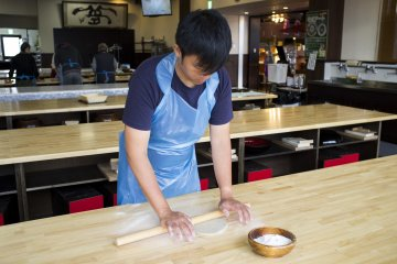<p>Pinning the soba dough down and trying flatten it as much as possible</p>