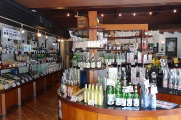<p>Inside the shop, there are many kinds, sizes, and prices of sake to choose from.</p>
