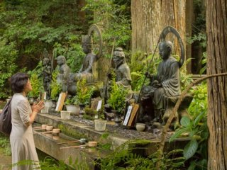 A lady praying in front of the Jizobosatsu statue at the base of Kami-Daigo in Kyoto!