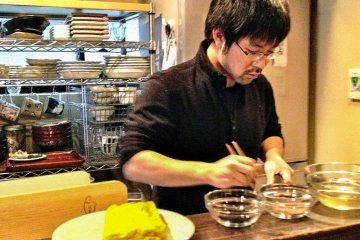 Teacher Taro san on a roll in the kitchen, chatting, cooking, laughing, all the same time