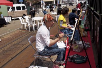 <p>Creators&#39; Cafe: Artists hard at work</p>