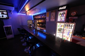 <p>The relaxed atmosphere of Stickers bar showing selection of beverages and flat screen television.</p>