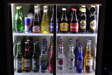 <p>A variety of overseas favorites on display in the bar fridge.&nbsp;</p>